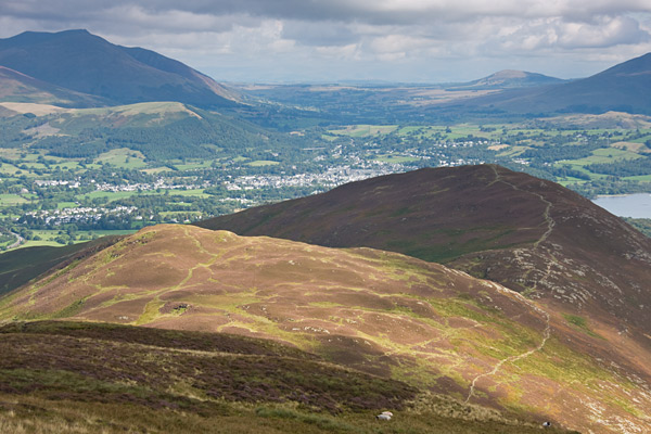 Blencathra above Latrigg with Great Mell Fell in the distance on the right. Nearer are Stile End in the sun and Barrow.